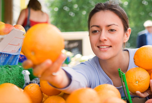 getty_rf_photo_of_woman_with_oranges