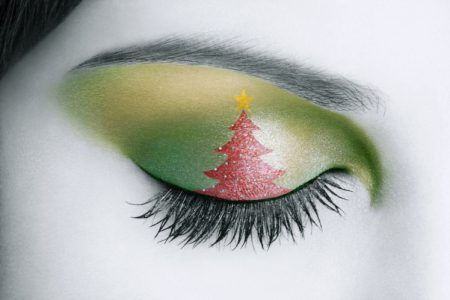 Personnal interpretation of a close-up of a woman eye with a draw of A Christmas three.